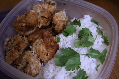 coconut shrimp packed for lunch with coconut rice & cilantro garnish