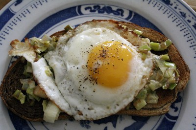 Pumpernickel-Rye swirl toast topped with creamed leeks and an over-easy fried egg.
