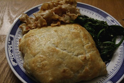 Salmon in Puff Pastry with Rice - uncut with a side of spinach and pasta